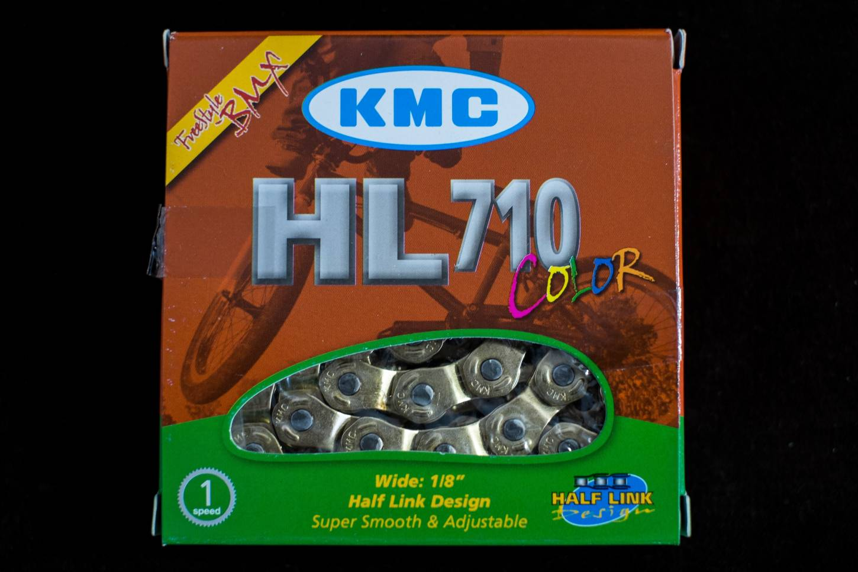 KMC HL710 Half Link Kette - 1 Fach - 1/2 x 1/8 - silber + gold - 104 Links